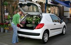 Florist loading Ford Fiesta van