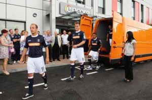 Luton Town FC players striding out of the Vauxhall Movano changing room