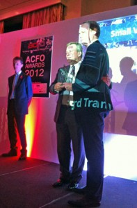 Kevin Griffin, fleet director of Ford, accepts the ACFO van award