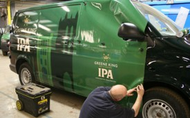 Vehicle wrap being applied to Greene King van at Bri-Stor's in-house graphics department