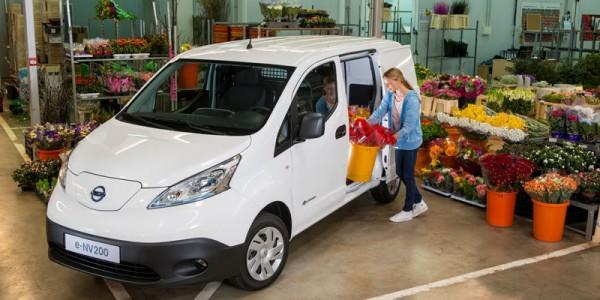 Florist loading up a Nissan eNV200