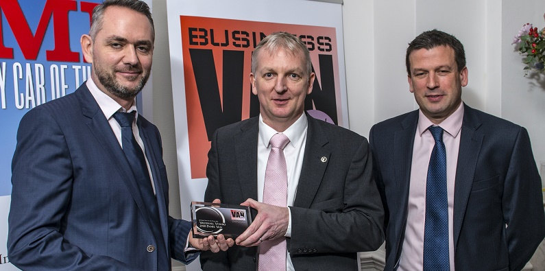 Vauxhall product manager Brad Miller receives the Business Van of the year award from Andy Alderson, managing director of sponsor Vanarama, and Dave Bowen, chairman of the judges and managing director of BT Fleet