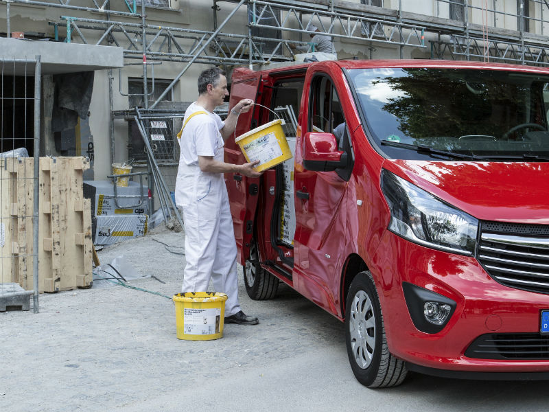Decorator loading up a Vivaro van bought on finance lease