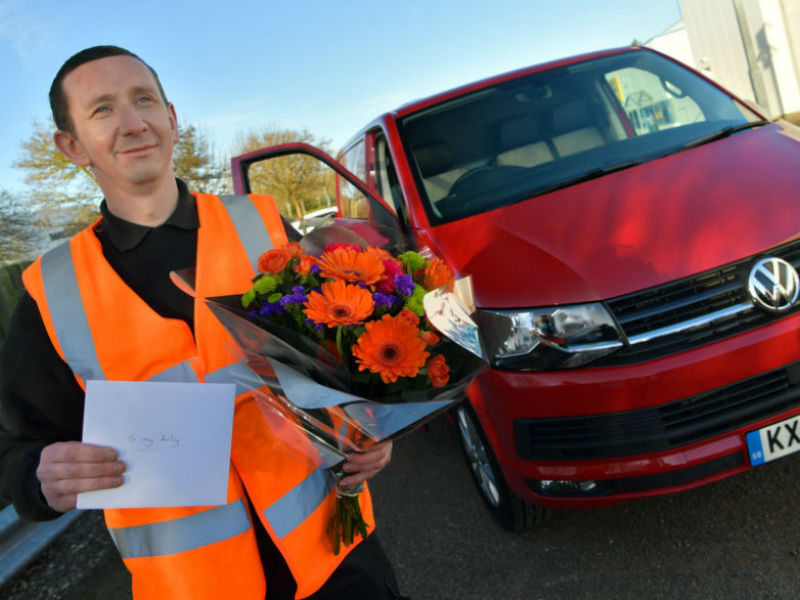 Van driver with flowers