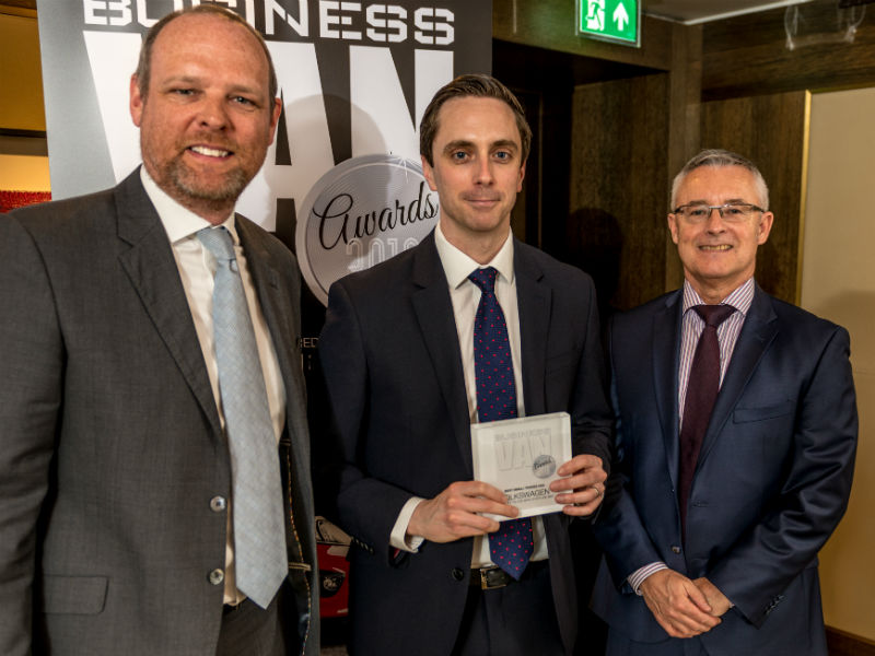 David Hanna, Head of Fleet at Volkswagen Commercial Vehicles, receives the Best Small Trades Van Award from Chair of the Judges Paul Hollick (left) and award sponsor Colin Parnell of Vansdirect at the Business Van of the Year Awards 2018