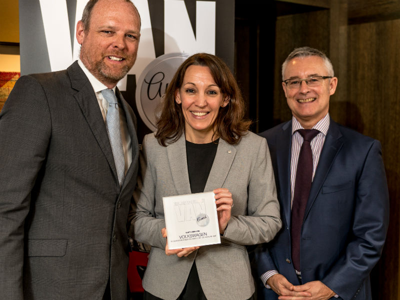 Kate Thompson, Head of Press and Public Relations at Volkswagen Commercial Vehicles, receives the Best Crew Van award from Chair of the Judges Paul Hollick (left) and award sponsor Colin Parnell of Vansdirect at the Business Van of the Year Awards 2018