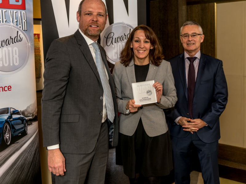 Kate Thompson, Head of Press and Public Relations at Volkswagen Commercial Vehicles, receives the Best Heavy Van Award from Chair of the Judges Paul Hollick (left) and award sponsor Colin Parnell of Vansdirect at the Business Van of the Year Awards 2018