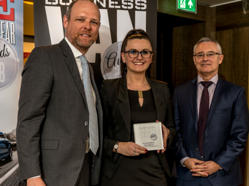 Louise Neilson, Head of Business Sales - Peugeot, receives the Best Large Trades Van Award from Chair of the Judges Paul Hollick (left) and award sponsor Colin Parnell of Vansdirect at the Business Van of the Year Awards 2018