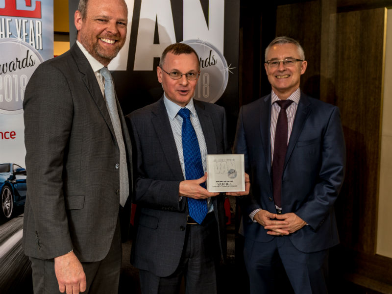 Sandy MacRitchie, Marketing Manager, Commercial Vehicles at Vauxhall, receives the Best Small Delivery Van Award from Chair of the Judges Paul Hollick (left) and award sponsor Colin Parnell of Vansdirect at the Business Van of the Year Awards 2018