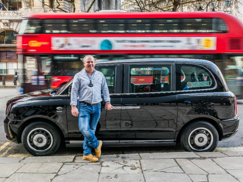 Taxi driver David Harris receives his new LEVC TX electric taxi