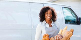 Female baker with her van