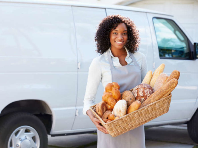 Female baker with her van